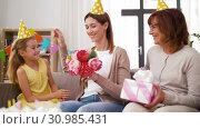 Купить «daughter with gift box greeting mother on birthday», видеоролик № 30985431, снято 14 июня 2019 г. (c) Syda Productions / Фотобанк Лори