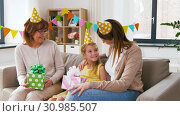 Купить «family greeting girl with birthday at home party», видеоролик № 30985507, снято 14 июня 2019 г. (c) Syda Productions / Фотобанк Лори
