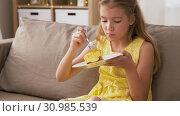 Купить «girl eating cake at home», видеоролик № 30985539, снято 14 июня 2019 г. (c) Syda Productions / Фотобанк Лори