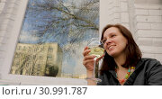 Attractive female with glass of refreshing drink. Стоковое видео, видеограф Ekaterina Demidova / Фотобанк Лори
