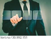 Man in suit touching screen. Стоковое фото, фотограф Яков Филимонов / Фотобанк Лори