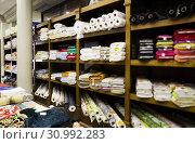 Купить «different fabric bolts exposed on shelves», фото № 30992283, снято 2 марта 2018 г. (c) Яков Филимонов / Фотобанк Лори