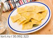 Купить «Plate of freshly boiled ravioli», фото № 30992323, снято 21 августа 2019 г. (c) Яков Филимонов / Фотобанк Лори