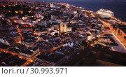 Купить «Night aerial view of downtown of Lisbon overlooking medieval Cathedral and Castle of Sao Jorge, Portugal», видеоролик № 30993971, снято 22 мая 2019 г. (c) Яков Филимонов / Фотобанк Лори