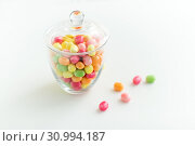 Купить «glass jar with candy drops over white background», фото № 30994187, снято 6 июля 2018 г. (c) Syda Productions / Фотобанк Лори