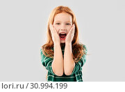 shocked or surprised red haired girl screaming. Стоковое фото, фотограф Syda Productions / Фотобанк Лори