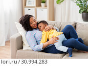 Купить «happy african american mother with baby at home», фото № 30994283, снято 22 марта 2019 г. (c) Syda Productions / Фотобанк Лори