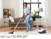 Купить «woman or housewife with vacuum cleaner at home», фото № 30994287, снято 7 апреля 2019 г. (c) Syda Productions / Фотобанк Лори
