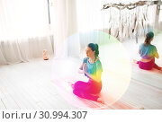 Купить «woman meditating at yoga studio», фото № 30994307, снято 21 июня 2018 г. (c) Syda Productions / Фотобанк Лори