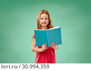 Купить «red student girl with book over school chalk board», фото № 30994359, снято 9 марта 2019 г. (c) Syda Productions / Фотобанк Лори