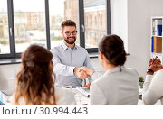 recruiters having job interview with male employee. Стоковое фото, фотограф Syda Productions / Фотобанк Лори