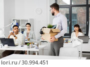 fired male office worker with personal stuff. Стоковое фото, фотограф Syda Productions / Фотобанк Лори