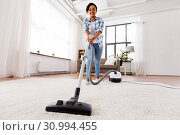 Купить «woman or housewife with vacuum cleaner at home», фото № 30994455, снято 7 апреля 2019 г. (c) Syda Productions / Фотобанк Лори