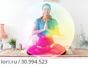 Купить «woman meditating in lotus pose at yoga studio», фото № 30994523, снято 21 июня 2018 г. (c) Syda Productions / Фотобанк Лори