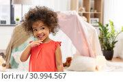 Купить «happy little african american girl at home», фото № 30994567, снято 9 марта 2019 г. (c) Syda Productions / Фотобанк Лори