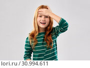 Купить «smiling red haired girl holding to her head», фото № 30994611, снято 9 марта 2019 г. (c) Syda Productions / Фотобанк Лори