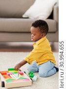 Купить «african american baby boy playing with toy blocks», фото № 30994655, снято 22 марта 2019 г. (c) Syda Productions / Фотобанк Лори