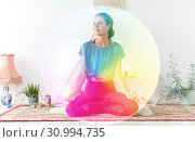 Купить «woman meditating in lotus pose at yoga studio», фото № 30994735, снято 21 июня 2018 г. (c) Syda Productions / Фотобанк Лори
