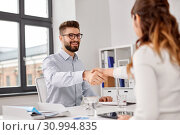 Купить «recruiters having job interview with male employee», фото № 30994835, снято 23 марта 2019 г. (c) Syda Productions / Фотобанк Лори