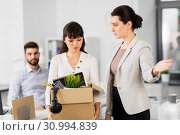 fired sad female office worker leaving. Стоковое фото, фотограф Syda Productions / Фотобанк Лори