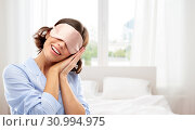 happy young woman in pajama and eye sleeping mask. Стоковое фото, фотограф Syda Productions / Фотобанк Лори