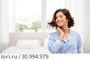 Купить «happy young woman in pajama over bedroom», фото № 30994979, снято 6 марта 2019 г. (c) Syda Productions / Фотобанк Лори