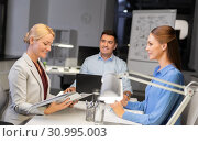 Купить «business team with laptop working late at office», фото № 30995003, снято 6 декабря 2017 г. (c) Syda Productions / Фотобанк Лори