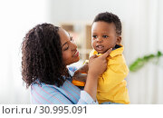 Купить «happy african american mother with baby at home», фото № 30995091, снято 22 марта 2019 г. (c) Syda Productions / Фотобанк Лори