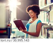 Купить «happy african student girl reading book at library», фото № 30995143, снято 19 июня 2016 г. (c) Syda Productions / Фотобанк Лори