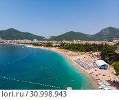 Aerial view of long coastline of Budva city, Montenegro. Balkans, Adriatic sea, Europe (2019 год). Стоковое фото, фотограф Володина Ольга / Фотобанк Лори