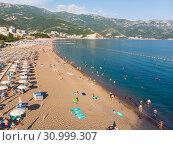 Купить «Becici, Montenegro - June 12.2019. Beautiful top view of the beach with people.», фото № 30999307, снято 11 июня 2019 г. (c) Володина Ольга / Фотобанк Лори