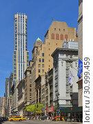 Купить «Fifth Avenue, major thoroughfare in borough of Manhattan. New York City, USA», фото № 30999459, снято 11 мая 2019 г. (c) Валерия Попова / Фотобанк Лори