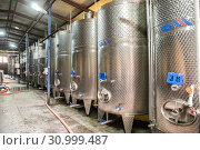 Купить «Fermentation tanks for wine production on the plant Kindzmarauli Corporation», фото № 30999487, снято 1 октября 2018 г. (c) Юлия Бабкина / Фотобанк Лори