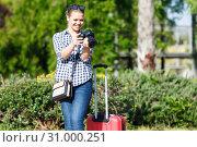 Купить «Happy woman traveler making photo of sights», фото № 31000251, снято 27 апреля 2018 г. (c) Яков Филимонов / Фотобанк Лори