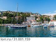 Купить «Herceg Novi, Montenegro - June 10. 2019. Yachts in port on the background of the city», фото № 31001159, снято 10 июня 2019 г. (c) Володина Ольга / Фотобанк Лори