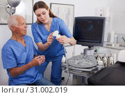 Купить «elderly doctor and nurse in cabinet of ultrasound test», фото № 31002019, снято 7 мая 2019 г. (c) Яков Филимонов / Фотобанк Лори