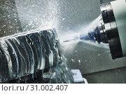 CNC milling machine work. Coolant and lubrication in metalwork industry. Стоковое фото, фотограф Дмитрий Калиновский / Фотобанк Лори