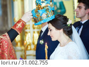 Groom and bride on the wedding ceremony in orthodox church. Стоковое фото, фотограф Дмитрий Калиновский / Фотобанк Лори
