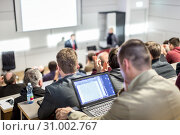 Купить «Business speaker giving a talk at business conference event.», фото № 31002767, снято 11 декабря 2014 г. (c) Matej Kastelic / Фотобанк Лори