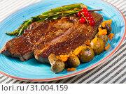 Купить «Image of beef entrecote with mushroom and asparagus», фото № 31004159, снято 29 июня 2018 г. (c) Яков Филимонов / Фотобанк Лори
