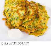 Купить «Image of zucchini fritters and white sauce at plate», фото № 31004171, снято 7 июля 2020 г. (c) Яков Филимонов / Фотобанк Лори