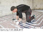 Купить «underfloor heating installation. warm Floor Heating system», фото № 31004811, снято 4 марта 2019 г. (c) Дмитрий Калиновский / Фотобанк Лори