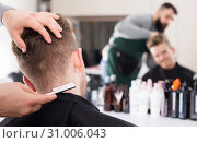 Купить «male hairdresser doing haircut for male client at hair salon», фото № 31006043, снято 27 января 2017 г. (c) Яков Филимонов / Фотобанк Лори
