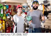 Купить «Couple deciding on climbing equipment», фото № 31006107, снято 24 февраля 2017 г. (c) Яков Филимонов / Фотобанк Лори