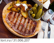 Купить «Beef entrecote with spices on a wooden round board», фото № 31006207, снято 17 июля 2019 г. (c) Яков Филимонов / Фотобанк Лори