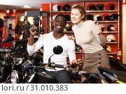 Купить «Couple posing on purchased motorcycle», фото № 31010383, снято 16 января 2019 г. (c) Яков Филимонов / Фотобанк Лори