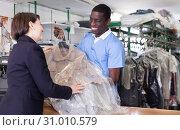 Купить «Administrator returning clothing to female client», фото № 31010579, снято 15 января 2019 г. (c) Яков Филимонов / Фотобанк Лори