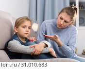 Dissatisfied mother scolds little girl. Стоковое фото, фотограф Яков Филимонов / Фотобанк Лори