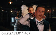 Купить «Retro theme party - Attractive young men showing off their costumes by rotation - a performance», видеоролик № 31011467, снято 16 июля 2019 г. (c) Константин Шишкин / Фотобанк Лори