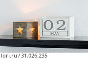 Купить «White block calendar present date 3 and month May on white wall background», фото № 31026235, снято 11 декабря 2017 г. (c) easy Fotostock / Фотобанк Лори